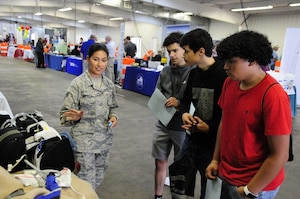 SrA Maria Moposita, a medical technician with the 459 AES, talks to students about her career at the 14th Annual Northern .Transportation Career Fair for High School Students in Manassas, Va. The career fair is part of a Federal Highway Administration initiative to promote the transportation industry and the careers it offers to America's youth.