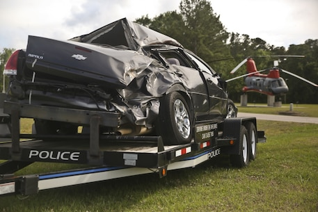 """A static display of a wrecked car is displayed aboard Marine Corps Air Station Beaufort May 14. The display was set up to show the dangers of distracted and drunk driving as well as to bring awareness to how Marines can stay safe during the """"101 Days of Summer""""."""