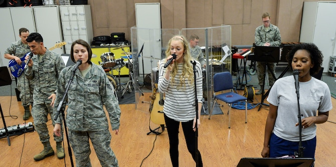 Singer Alexis Gomez, rehearses with the Air Force Band of Flight inside their offices at Wright-Patterson Air Force Base, Ohio, Sept. 27. 2018.