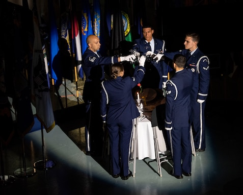 Members of the Eglin Honor Guard perform missing man table honors during the POW/MIA ceremony Sept. 21, 2018, at the Air Force Armament Museum located near Eglin Air Force Base, Fla. The ceremony was held in remembrance of America's prisoners of war, those still missing in action and their families. (U.S. Air Force photo by Ilka Cole)