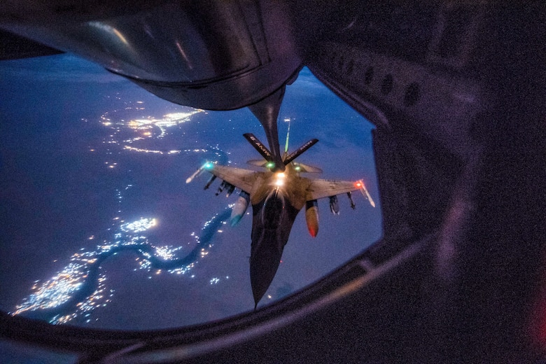 An Air Force F-16 Fighting Falcon, assigned to the 157th Expeditionary Fighter Squadron, receives in-flight fuel from a KC-135 Stratotanker during a mission in support of Operation Inherent Resolve over Iraq, Sept. 21, 2018. U.S. and Coalition aircraft provide unmatched combat capability in support of U.S. Central Command military objectives. (U.S. Air Force photo by Staff Sgt. Keith James)