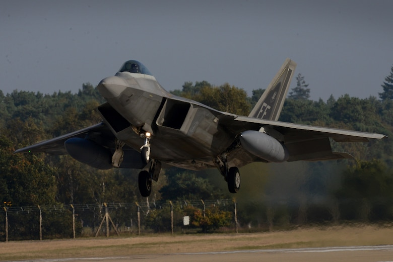 An F-22 Raptor assigned to the 1st Fighter Wing, Joint Base Langley-Eustis, Va. lands at Royal Air Force Lakenheath, England Oct. 5, 2018. The Raptors will train with U.S. allies and partners as a demonstration of U.S. commitment to European regional security. (U.S. Air Force photo/ Tech. Sgt. Matthew Plew)