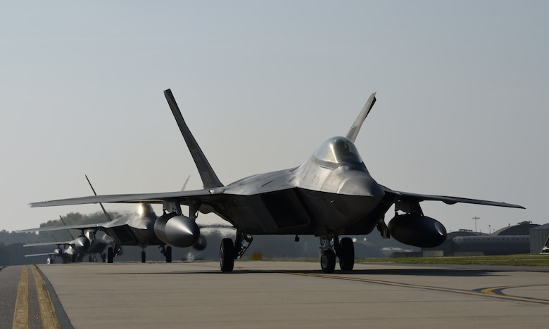 F-22 Raptors assigned to the 1st Fighter Wing, Joint Base Langley-Eustis, Va., taxi down the flightline at Royal Air Force Lakenheath, England, Oct. 5, 2018. As the world's premiere operational 5th-generation fighter, the Raptor's unique combination of stealth, speed, agility and situational awareness combined with lethal long-range air-to-air and air-to-ground weaponry make it the best air dominance fighter in the world. (U.S. Air Force photo/Staff Sgt. Alex Fox Echols III)