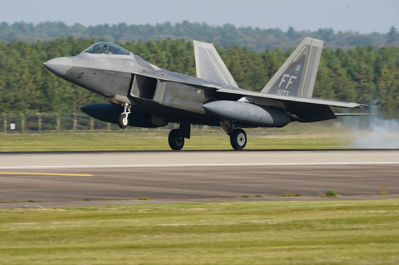 An F-22 Raptor lands at Royal Air Force Lakenheath, England, Oct. 5, 2018.  The F-22 Raptors, Airmen and associated equipment arrived at RAF Lakenheath, England, for a short-term deployment to the U.S. European Command area of operations. (U.S. Air Force photo by Airman 1st Class Shanice Williams-Jones)