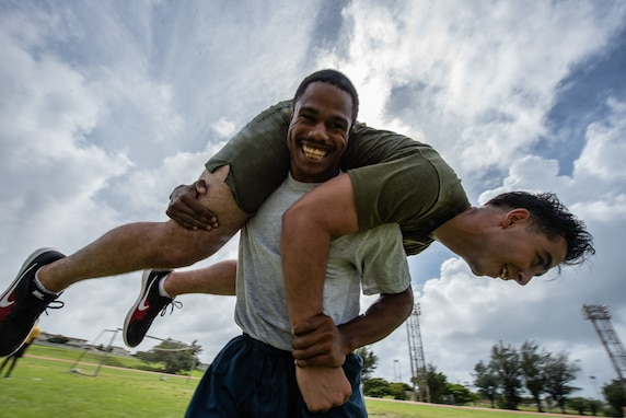 Air Force Staff Sgt. Amann Davis, Okinawa Joint Experience Red Team student, carries Marine Corps Sgt. Thomas Warren, OJE Red Team student, during the Okinawa Joint Fitness Challenge Sept. 26, 2018, at Kadena Air Base, Japan. The OJFC was designed to mimic obstacles and challenges faced in the battlefield such as sprinting, running ammunition cans, transporting wounded personnel to safety and tossing simulated grenades. (U.S. Air Force photo by Staff Sgt. Micaiah Anthony)