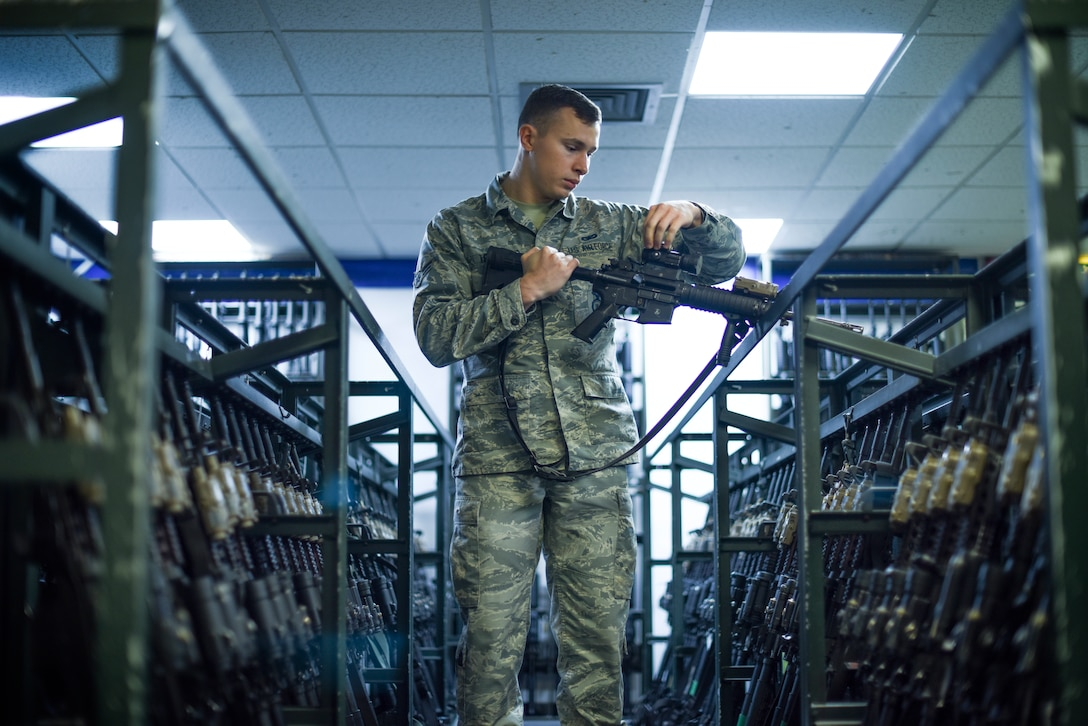Airman 1st Class Nicholas Terry, 100th Security Forces Squadron armorer, inspects an M-4 carbine rifle at RAF Mildenhall, Great Britain, Sept. 25, 2018. After each shift, weapons must be cleared by security forces Airmen and then turned into the armory for security until the individual needs it again for duty. (U.S. Air Force photo by Airman 1st Class Brandon Esau)