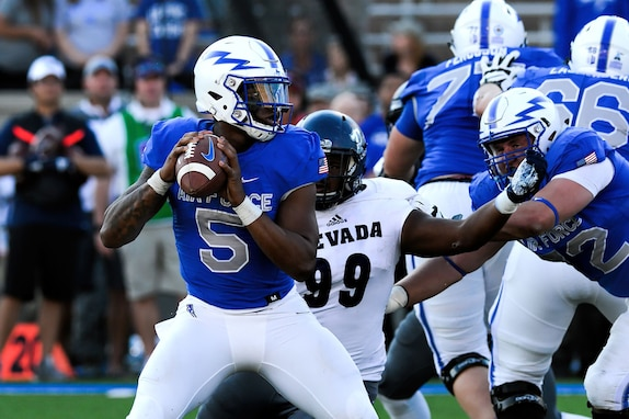 Donald Hammond III, U.S. Air Force Academy Falcons quarterback, looks to make a pass during a game against the Nevada Wolfpack at Falcon Stadium in Colorado Springs, Colo., Sept. 29, 2018. The Wolfpack defeated the Falcons 28-25 as a furious fourth quarter comeback by the Falcons fell short. (U.S. Air Force photo by Bill Evans)