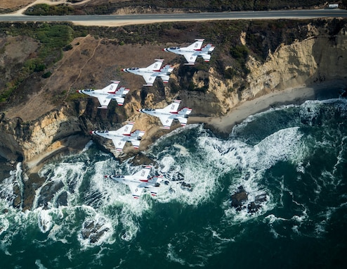 "The U.S. Air Force Air Demonstration Squadron ""Thunderbirds"" fly near the Pacific Coast Oct. 1, 2018, while returning to Nellis Air Force Base, Nev. Since 1953, the Thunderbirds have served as America's premier air demonstration squadron. (U.S. Air Force photo by Staff Sgt. Ashley Corkins)"