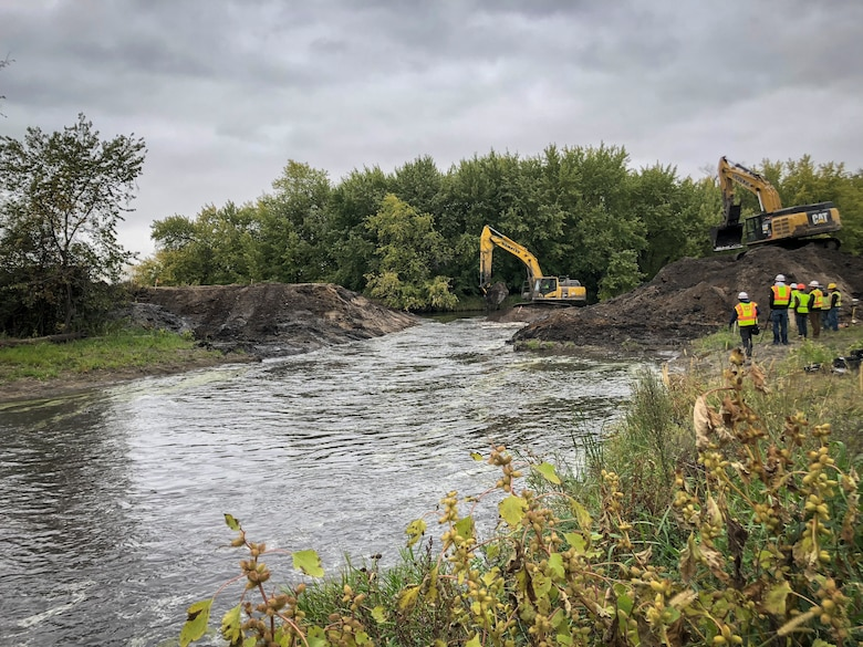 heavy equipment breaches dam embankment
