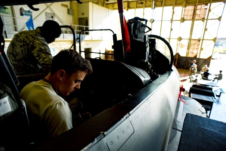 Electrical and environmental systems apprentice course Airmen replace components on an F-15 Eagle.