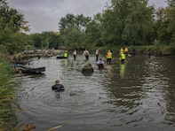 crews search river bottom for mussels