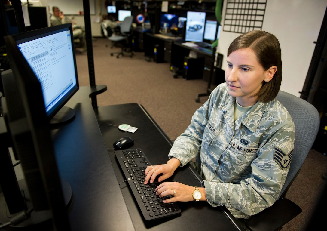 Staff Sgt. Elizabeth Caulfield, Signals Analysis Squadron scientific and technical signals analyst, conducts mission operations July 11 at the National Air and Space Intelligence Center on Wright-Patterson Air Force Base, Ohio. Caulfield was named one of the 12 Outstanding Airmen of the Year for the Air Force. (U.S. Air Force photo/ Senior Airman Michael Hunsaker)