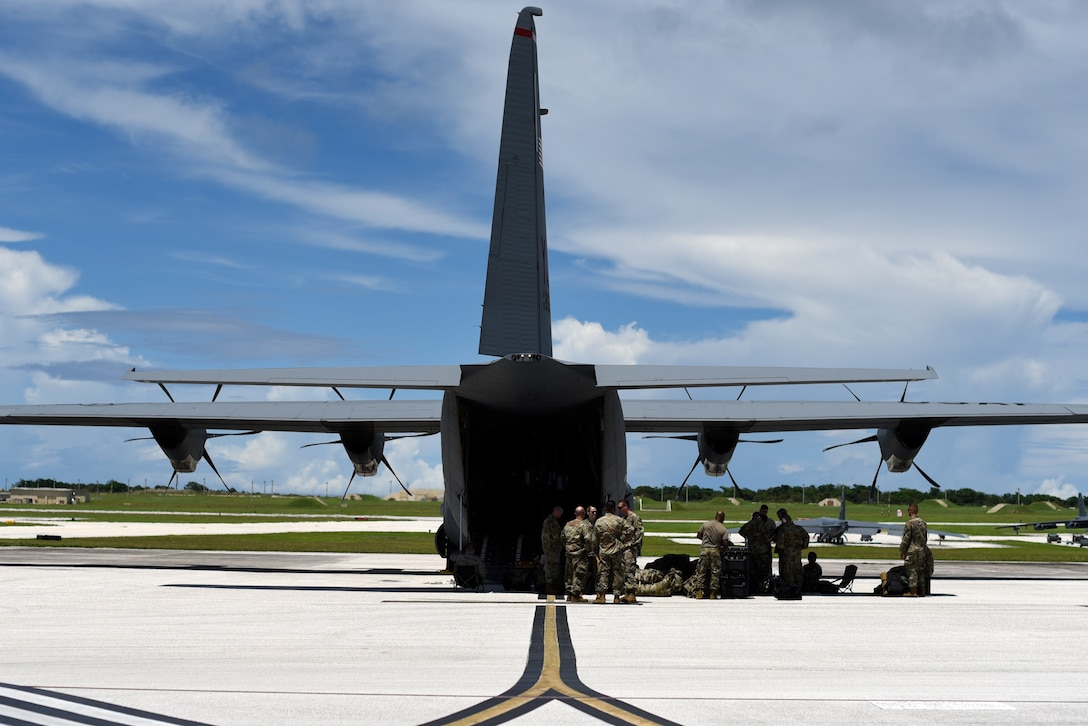 Airmen assigned to the 36th Contingency Response Group prepare to load a C-130J Super Hercules Oct. 05, 2018, at Andersen Air Force Base, Guam. United States Indo-Pacific Command is deploying as part of the broader U.S. Government effort to support Indonesia's request for humanitarian assistance.  This effort includes coordination with the U.S. Department of State and U.S. Agency for International Development, in constant consultation with Indonesian authorities. (U.S. Air Force photo by Senior Airman Gerald R. Willis)