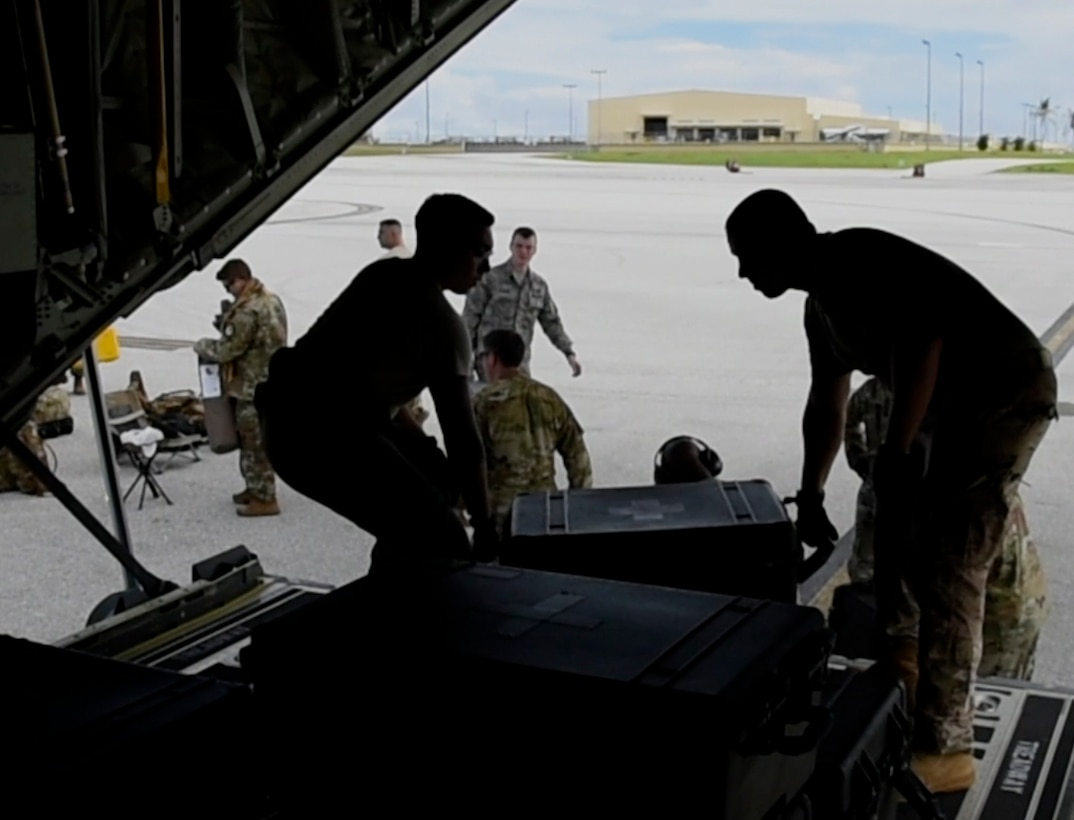 Airmen assigned to the 36th Contingency Response Group load a C-130J Super Hercules Oct. 05, 2018, at Andersen Air Force Base, Guam. United States Indo-Pacific Command is deploying as part of the broader U.S. Government effort to support Indonesia's request for humanitarian assistance.  This effort includes coordination with the U.S. Department of State and U.S. Agency for International Development, in constant consultation with Indonesian authorities. (U.S. Air Force photo by Senior Airman Gerald R. Willis)