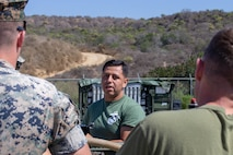 U.S. Marine Corps Sgt. Aaron Salcidosoto, center, a water support technician with the Combat Engineer detachment, Task Force Koa Moana, teaches a class to other Task Force Koa Moana Marines at Marine Corps Base Camp Pendleton, Calif., Sept. 26, 2018. Salcidosoto taught a class about the functions and capabilities of the lightweight water purification system. (U.S. Marine Corps photo by Cpl. Branden J. Bourque)
