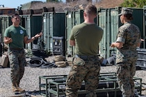 From left, U.S. Marine Corps Sgt. Aaron Salcidosoto, a water support technician with the combat engineer detachment, teaches a class to Lance Cpl. Matt Michels, a combat engineer, and Lance Cpl. Elizabeth Magee, a drafter and surveyor, all with Task Force Koa Moana, at Marine Corps Base Camp Pendleton, Calif., Sept. 26, 2018. Salcidosoto taught a class about the functions and capabilities of the lightweight water purification system. (U.S. Marine Corps photo by Cpl. Branden J. Bourque)