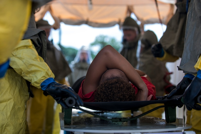A patient is slid through a simulated decontamination tent during a 6th Air Mobility Wing operational readiness assessment (ORA) Oct. 4, 2018 at MacDill Air Force Base, Fla.