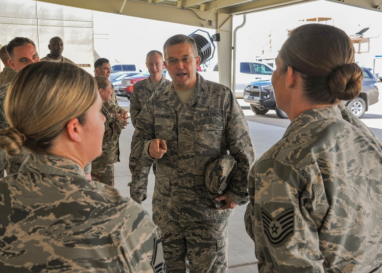 Air Force Global Strike Command's Command Chaplain, Chap. (Col.) Randall Kitchens, greets the 377th Medical Group's Tech. Sgt. Margueriete Pinnix (left) and Master Sgt. Kate Grady (right) during a visit to Kirtland Air Force Base, N.M., Oct. 3, 2018. They visited Kirtland to gauge spiritual resiliency among Striker Airmen at the base. (U.S. Air Force photo by Jim Fisher)