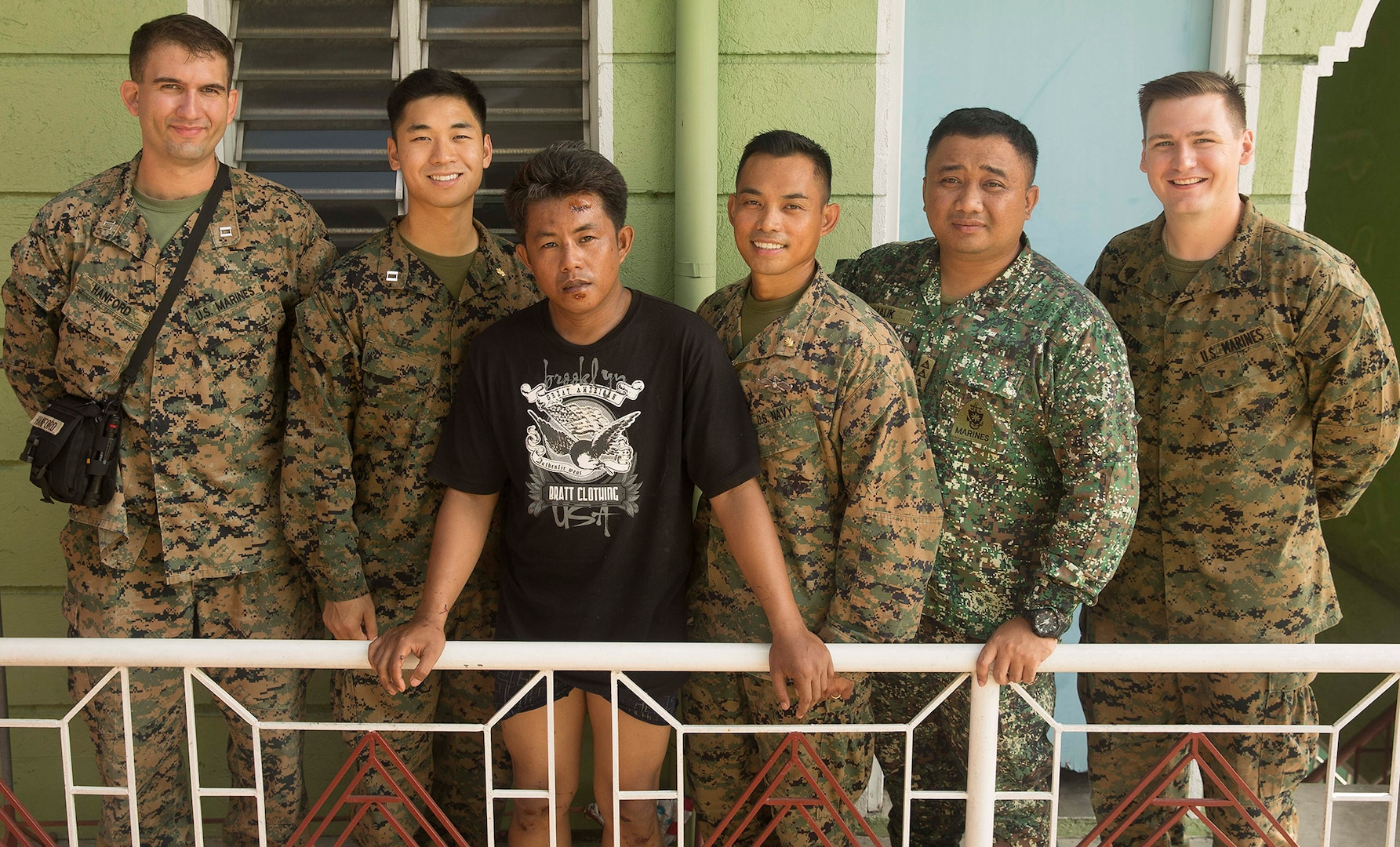 U.S. Marines and Sailors aid in local accident