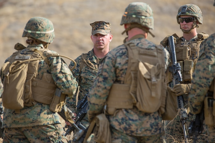 U.S. Marine Corps Sgt. Tyler C. Strawser, back center, the guide for Bravo Company, 7th Engineer Support Battalion (ESB), Task Force Koa Moana (TF KM), briefs 7th ESB Marines during the TF KM Mission Rehearsal Exercise at Marine Corps Base Camp Pendleton, Calif., July 18, 2018. The exercise confirmed TF KM is capable of cross cultural interaction, instruction, and relationship building while training alongside partner nations in order to meet Theater Security Cooperation engagement objectives. (U.S. Marine Corps photo by Staff Sgt. Gabriela Garcia)