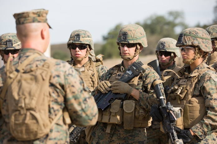 U.S. Marine Corps Staff Sgt. Joshua G. Nickell, the platoon sergeant for Bravo Company, 7th Engineer Support Battalion (ESB), Task Force Koa Moana (TF KM), briefs 7th ESB Marines during the TF KM Mission Rehearsal Exercise at Marine Corps Base Camp Pendleton, Calif., July 18, 2018. The exercise confirmed TF KM is capable of cross cultural interaction, instruction, and relationship building while training alongside partner nations in order to meet Theater Security Cooperation engagement objectives. (U.S. Marine Corps photo by Staff Sgt. Gabriela Garcia)