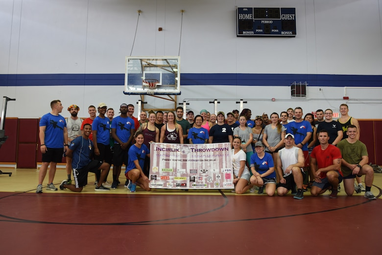 Competitors, spectators and volunteers pose for a photo after the Incirlik Throw Down CrossFit competition at Incirlik Air Base, Sept. 29, 2018.