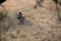 A U.S. Marine with Bravo Company, 7th Engineer Support Battalion, Task Force Koa Moana (TF KM), participates in a contact left attack during the TF KM Mission Rehearsal Exercise at Marine Corps Base Camp Pendleton, Calif., July 18, 2018. The exercise confirmed TF KM is capable of cross cultural interaction, instruction, and relationship building while training alongside partner nations in order to meet Theater Security Cooperation engagement objectives. (U.S. Marine Corps photo by Staff Sgt. Gabriela Garcia)