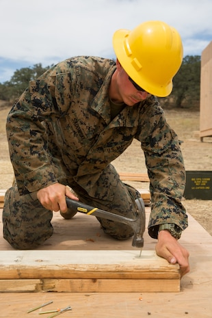 U.S. Marine Corps Lance Cpl. Jacob C. Sadowski, a combat engineer with Bravo Company, 7th Engineer Support Battalion, Task Force Koa Moana (TF KM), hammers a nail during the construction of a South West Asia hut during the TF KM Mission Rehearsal Exercise, at Marine Corps Base Camp Pendleton, Calif., July 18, 2018. The exercise confirmed TF KM is capable of cross cultural interaction, instruction, and relationship building while training alongside partner nations in order to meet Theater Security Cooperation engagement objectives. (U.S. Marine Corps photo by Staff Sgt. Gabriela Garcia)