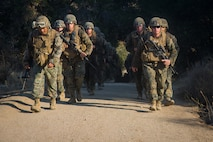 U.S. Marines with Task Force Koa Moana (TF KM) conduct a six mile hike during the TF KM Mission Rehearsal Exercise at Marine Corps Base Camp Pendleton, Calif., July 20, 2018. The exercise increased the task force capability and readiness to execute theatre security cooperation events during TF KM's deployment. (U.S. Marine Corps photo by Staff Sgt. Gabriela Garcia)