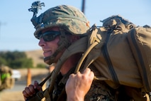 A U.S. Marine with Task Force Koa Moana (TF KM) conducts a six mile hike during the TF KM Mission Rehearsal Exercise at Marine Corps Base Camp Pendleton, Calif., July 20, 2018. The exercise increased the task force capability and readiness to execute theatre security cooperation events during TF KM's deployment. (U.S. Marine Corps photo by Staff Sgt. Gabriela Garcia)