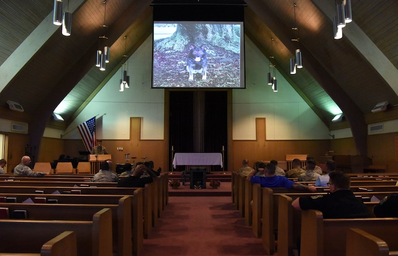 Keesler personnel attends a memorial service for Bady, 81st Security Forces Squadron military working dog, at the Larcher Chapel on Keesler Air Force Base, Mississippi, Oct. 4, 2018. Bady was accepted by the Air Force in 2010. He was certified on patrol and detection before being assigned to the 81st SFS where he completed countless hours of drug detection services over his eight-year career, as well as supporting U.S. customs and multiple local Law enforcement agencies. Bady worked with eight handlers before passing away at the age of 10 on June 14, 2018. (U.S. Air Force photo by Kemberly Groue)