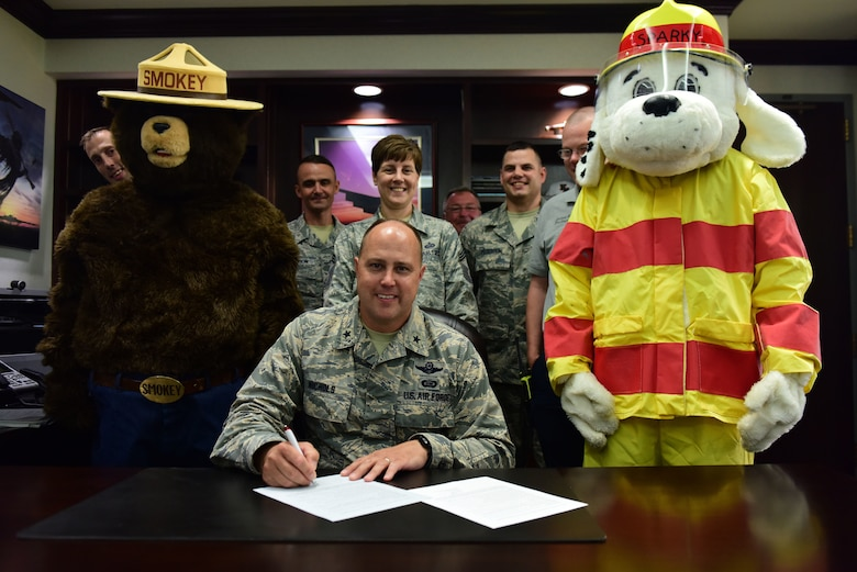 Brig. Gen. John Nichols, 509th Bomb Wing commander, signs the Fire Prevention Week Proclamation at Whiteman Air Force Base, Missouri, Sept. 5, 2018. National Fire Prevention Week is Oct. 7-13, 2018, and educates people about three basic, but essential, steps to reduce the likelihood of an accidental fire as well as how to escape safely if there is one. (U.S. Air Force photos by Staff Sgt. Joel Pfiester)