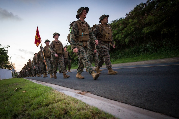 U.S. Marines assigned to Headquarters Battalion, Marine Corps Base Hawaii (MCBH), conducts a battalion hike, Oct. 5, 2018. The purpose of the hike was to increase physical and mental stamina, build espirit de corps, and to bolster combat readiness. (U.S. Marine Corps photo by Sgt. Aaron S. Patterson)