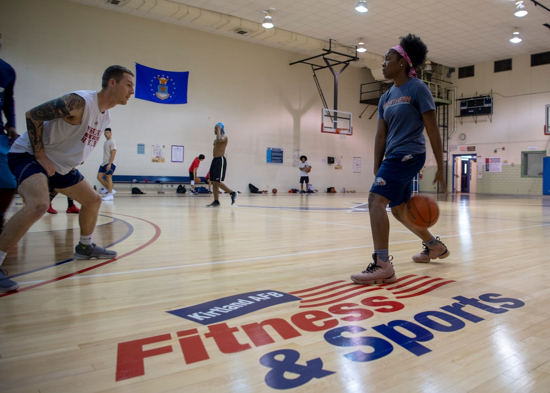 Members of Team Kirtland play a game of pick-up basketball in the newly renovated West Fitness Center at Kirtland Air Force Base, N.M., Oct. 4, 2018. The renovations included a new ventilation system and a resurfaced floor. (U.S. Air Force photo by Staff Sgt. J.D. Strong II)