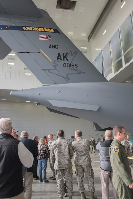 Members of the Alaska Air National Guard's 176th Wing and the Regular Air Force's 3rd Wing witnessed the unveiling of a new tail flash on the C-17 Globemaster IIIs assigned to the 176th Wing's 144th Airlift Squadron at Joint Base Elmendorf-Richardson, Alaska, Oct. 1, 2018. The new tail flash depicts a wolf head, (the 144th AS's emblem), on one side, and a firebird (the 517th AS's emblem), of equal size on the other. (U.S. Air National Guard photo by Tech. Sgt. N. Alicia Halla)