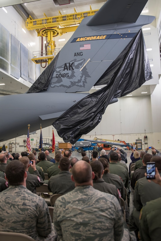 Members of the Alaska Air National Guard's 176th Wing and the Regular Air Force's 3rd Wing witnessed the unveiling of a new tail flash on the C-17 Globemaster IIIs assigned to the 176th Wing's 144th Airlift Squadron on Joint Base Elmendorf-Richardson, Alaska, Oct. 1, 2018. The new tail flash depicts a wolf head, (the 144th AS's emblem), on one side, and a firebird (the 517th AS's emblem), of equal size on the other. (U.S. Air National Guard photo by Tech. Sgt. N. Alicia Halla)
