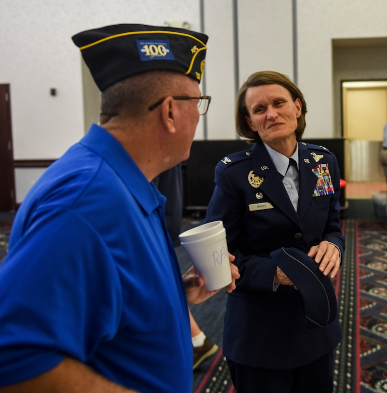 Col. Leslie Maher, 375th Air Mobility Wing commander, speaks with retired Air Force Capt. Ron Gilreath during Scott Air Force Base's 33rd annual Retiree Appreciation Day, Oct. 6, 2018. Retirees were given the opportunity obtain information from several booths including the American legion, Red Cross, Veterans of Foreign Wars, and Airman and Family readiness center as well as have the ability to receive immunizations and update identification cards.(U.S. Air Force Photo by Airman 1st Class Chad Gorecki)