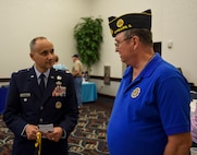 Col. Robert Grimmet, 375th Mission Support Group deputy commander, speaks with retired Air Force Col. Jim Harper during Scott Air Force Base's 33rd annual Retiree Appreciation Day, Oct. 6, 2018. Retirees were given the opportunity obtain information from several booths including the American Legion, Red Cross, Veterans of Foreign Wars, and Airman and Family Readiness Center as well as have the ability to receive immunizations and update identification cards. (U.S. Air Force Photo by Airman 1st Class Chad Gorecki)