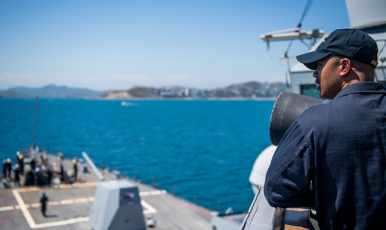 PORT MORESBY, Papua New Guinea (Oct. 6, 2018) Chief Fire Controlman Ryan Patricio stands lookout watch aboard the Arleigh-Burke class guided-missile destroyer USS Michael Murphy (DDG 112) arrives in Papua New Guinea. As the first U.S. Navy ship to visit Port Moresby since USS Comstock (LSD 45) in 2017, Michael Murphy arrives as the nation prepares to host the Asia-Pacific Economic Cooperation (APEC) Leaders' Summit for the first time in Nov. 2018. Michael Murphy is forward-deployed to the U.S. 7th Fleet area of operations in support of security and stability in the Indo-Pacific region.