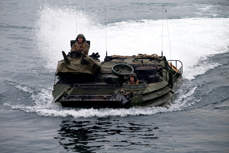 U.S. Marines with Assault Amphibious Vehicle Platoon, Echo Company, Battalion Landing Team 2nd Battalion, 5th Marines, 31st Marine Expeditionary Unit prepare to embark the USS Ashland in assault amphibious vehicles during KAMANDAG 2 in Subic Bay, Philippines, Oct. 3, 2018. KAMANDAG helps maintain a high level of readiness and enhances bilateral military-to-military relations and capabilities.