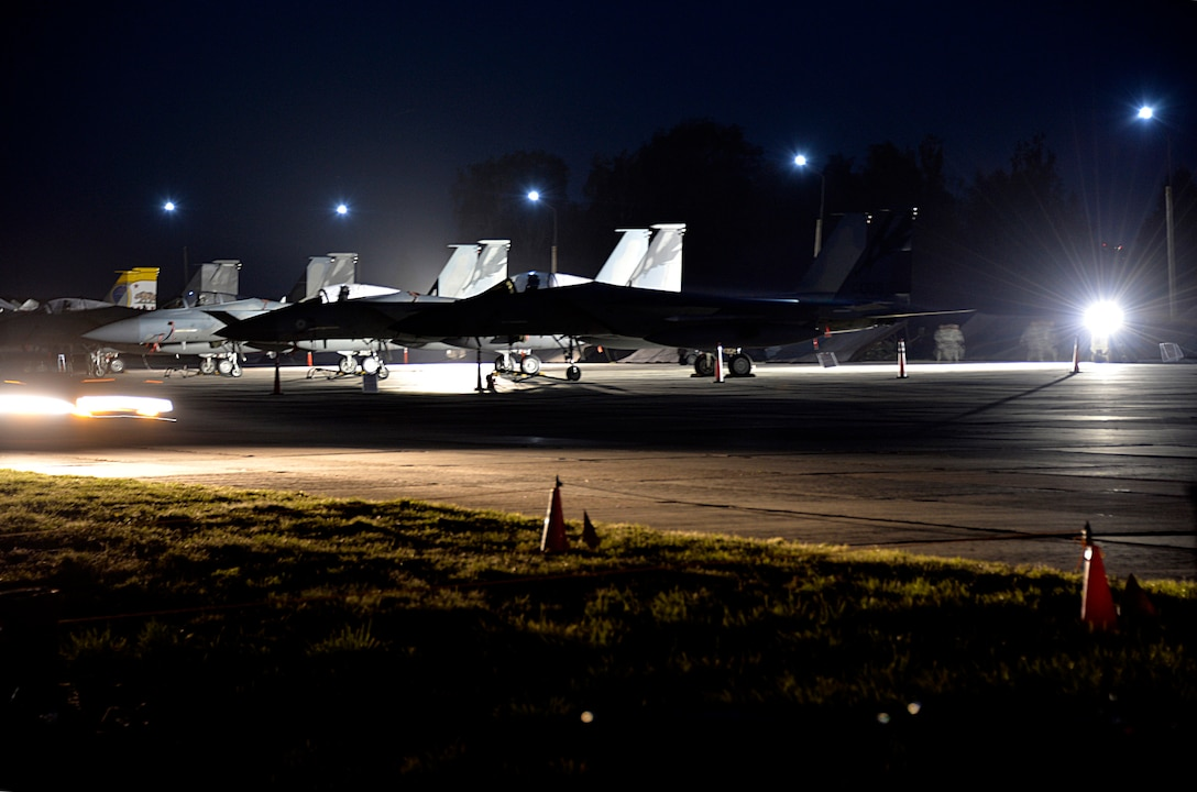 F-15C fighter jets from the California Air National Guard are secured for the evening on their first night at Starokostiantyniv Air Base, Ukraine, in preparation for participation in CLEAR SKY 2018.