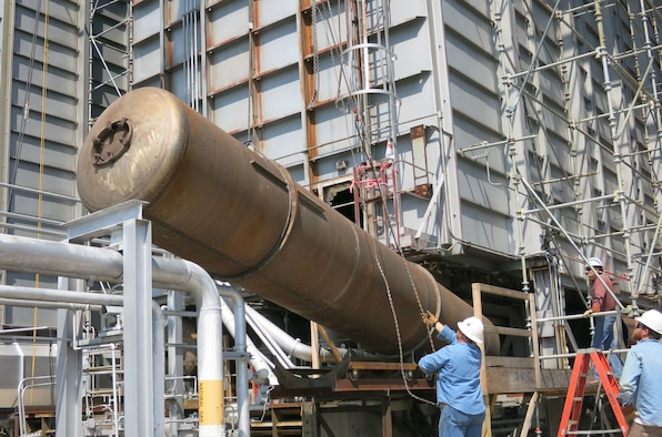 Workers remove one of lower headers at a C-Plant heater at the AEDC Engine Test Facility at Arnold Air Force Base. An innovative method was used when installing the new lower header ducts enabling craft crews to finish the project 7.5 weeks ahead of schedule with a cost savings of over $195,000. (AEDC photo)