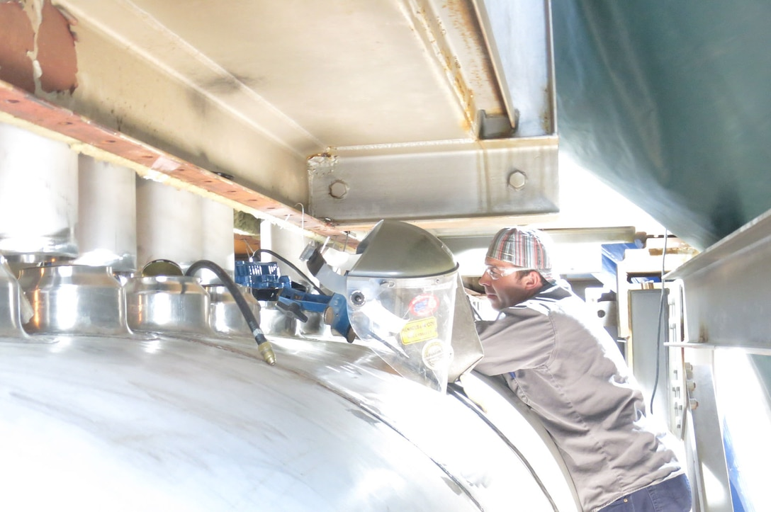 Boilermaker Mack Rogers works to install the header for one of the C-Plant heaters at the AEDC Engine Test Facility at Arnold Air Force Base. An innovative method was used when installing the new header ducts enabling craft crews to finish the project ahead of schedule. (AEDC photo)