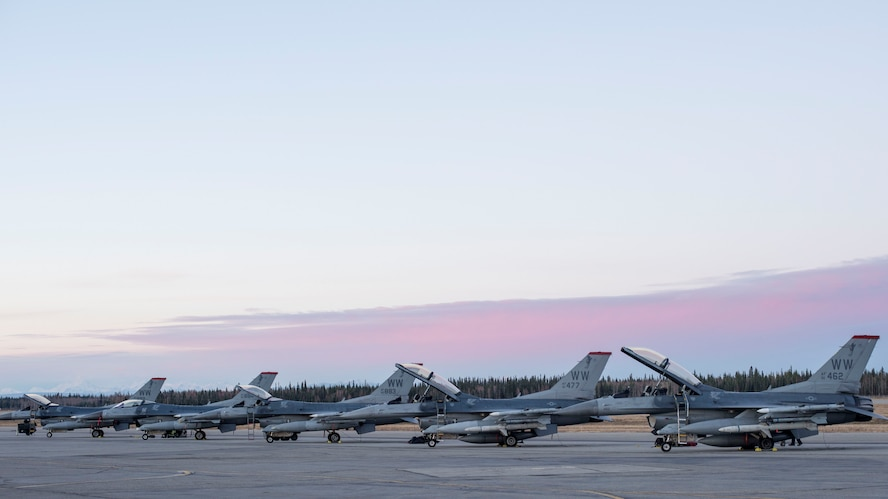 U.S. Air Force F-16 Fighting Falcons with the 13th Fighter Squadron sit on a runway during Exercise Red Flag-Alaska 19-1, at Eielson Air Force Base, Alaska, Oct. 6, 2018. RF-A 19-1, held Oct. 4 to 19, exposes all parties to combat-like scenarios to familiarize members with high-intensity, fast-paced operations to improve interoperability among allies. (U.S. Air Force photo by Airman 1st Class Collette Brooks)