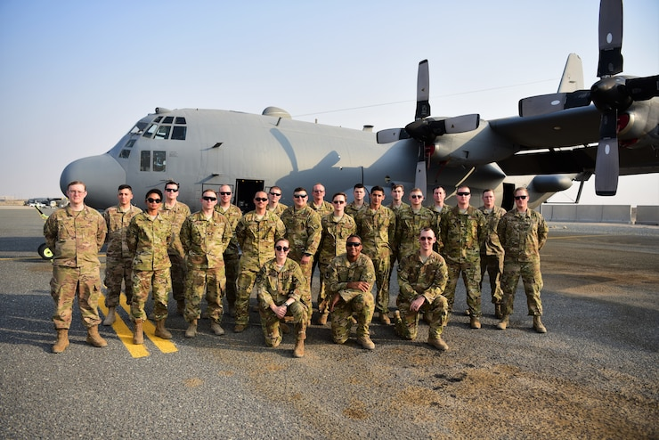 Members of the 43rd Expeditionary Electronic Combat Squadron and the 386th Expeditionary Aircraft Maintenance Squadron pose for a photo Sept. 21, 2018, at an undisclosed location in Southwest Asia. The 43rd EECS uses EC-130H aircraft to deny the communications capability enemy ground forces need to coordinate an attack, creating chaos and confusion. (U.S. Air Force photo by Staff Sgt. Christopher Stoltz)