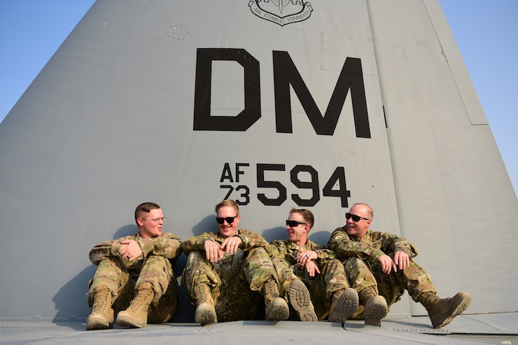 Maintainers from the 386th Expeditionary Aircraft Maintenance Squadron sit on the back of a 43rd Expeditionary Electronic Combat Squadron EC-130H aircraft Sept. 21, 2018, at an undisclosed location in Southwest Asia. The 43rd EECS and aircraft they fly provide communications jamming support to United States and coalition ground forces throughout the Central Command area of responsibility. (U.S. Air Force photo by Staff Sgt. Christopher Stoltz)
