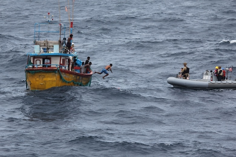 INDIAN OCEAN (Oct. 7, 2018) A Sri Lankan fisherman jumps and swims to a rigid-hull inflatable boat (RHIB) from the Arleigh Burke-class guided missile destroyer USS Decatur (DDG 73) after the ship stopped to render assistance to a stranded fishing vessel. After providing food and water, Decatur contacted the Sri Lankan authorities who came and towed the stranded vessel back to port. Decatur is forward deployed to the U.S. 7th Fleet area of operations in support of security and stability in the Indo-Pacific region.
