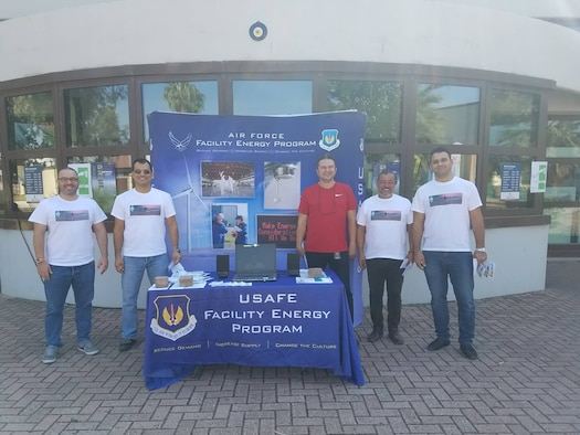 Members of the 39th Civil Engineer Squadron stand next to their table for Energy Action Month at Incirlik Air Base, Turkey, Oct. 5th, 2018.