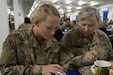 U.S. Army  Pvt. 1st Class Jenna Van Horn, a pharmacy specialist with the 452nd Combat Support Hospital, and her mother U.S. Army Maj. Lisa Van Horn, the chief of patient administration at the 452nd CSH, have lunch together, Camp Arifjan, Kuwait, Oct. 3, 2018. The work done by Soldiers in the  452nd CSH ensures that service members stationed in Central Command's area of responsibility remain healthy and capable of accomplishing their mission. (U.S. Army photo by Spc. Adam Parent)