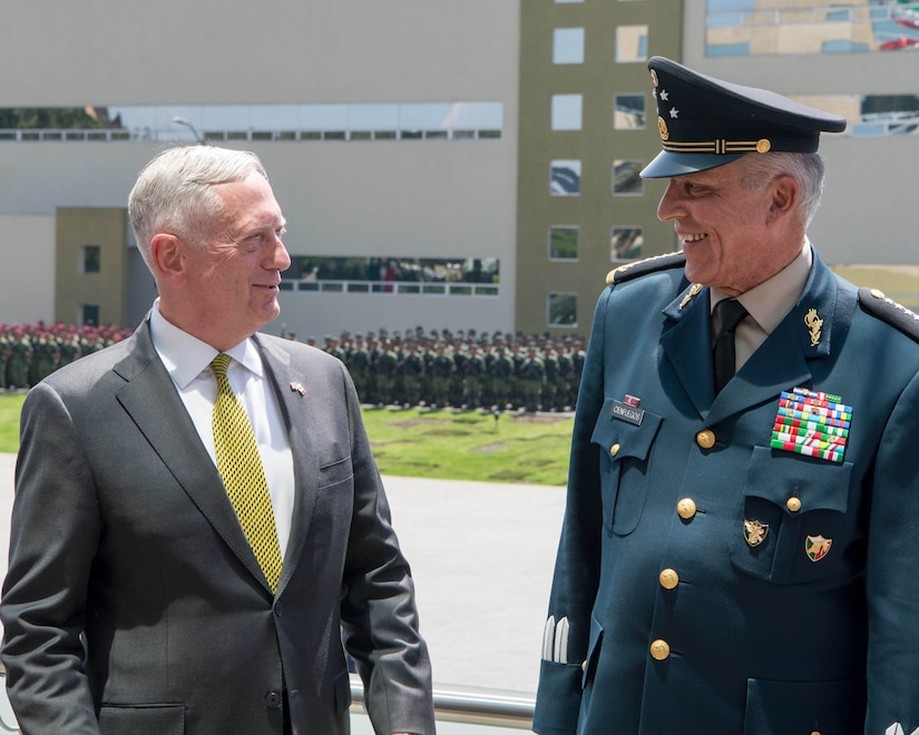 Defense Secretary Jim Mattis speaks with Mexican Army Gen. Salvador Cienfuegos Zepeda, the secretary of national defense, during an armed forces parade in Mexico City, Sept. 15, 2017. DOD photo by Air Force Staff Sgt. Jette Carr